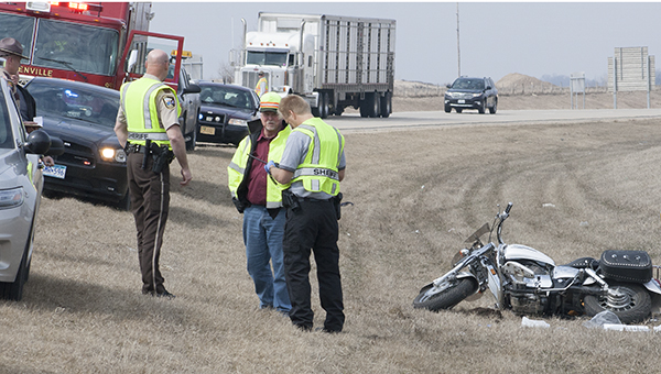 Freeborn County Sheriff's Office deputies and other authorities respond to a fatal motorcycle crash on Interstate 35 on April 8 about four miles north of the Iowa border.  --Sarah Stultz/Albert Lea Tribune