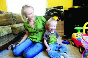 Kaiden Hoelz and his mother, Anne, are pictured in a feature in the Holiday 2013 issue of Albert Lea Magazine playing on the floor in their living room. --Brandi Hagen/Albert Lea Tribune