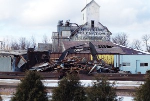 Crews demolish the former Frank Bros. Elevator off of Broadway on Wednesday afternoon. The large structure in the background is forfeited to the state and will at some point be for sale through a sheriff's sale. – Sarah Stultz/Albert Lea Tribune