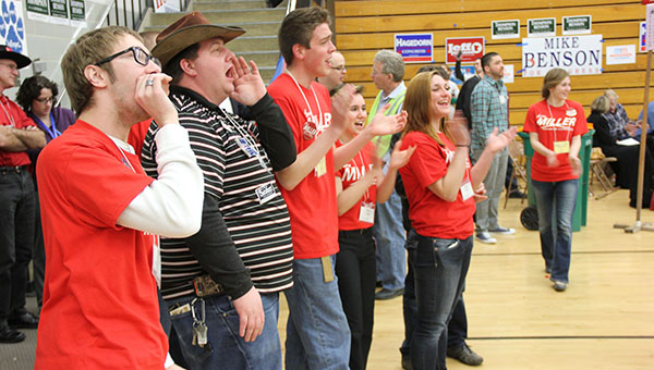 Young people cheer in favor of Aaron Miller after he tied for first place on the first round of balloting Saturday at the 1st District Republican Convention at Southwest Middle School in Albert Lea. From left are Spencer Krier, Richard Green, John Tingley, Mary Hough and Amber McCoy. -- Tim Engstroml/Albert Lea Tribune