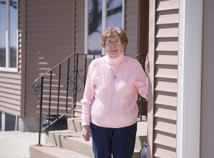 Delores Steele stands outside her home on her farm in Alden. While it sustained a lot of damage during the area tornadoes of 2010, the house has mostly kept its original structure with the exception of a few updates and a bathroom and garage addition. – Colleen Harrison/Albert Lea Tribune