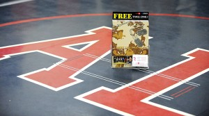 The magazine with history from the start of the Albert Lea wrestling program sits on a mat in the high school wrestling room. — Micah Bader/Albert Lea Tribune