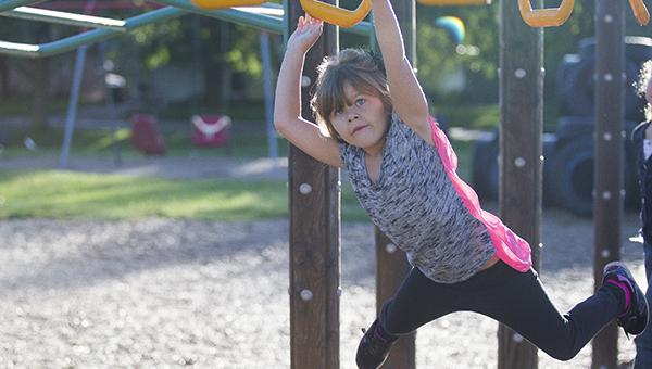 Second grader Raelynn Rasmussen, 7, plays on the playground before the start of school this morning at Halverson Elementary School. – Colleen Harrison/Albert Lea Tribune