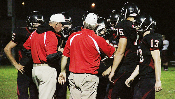 Alden-Conger coaches huddle with players during a timeout taken with 2.5 seconds left in the first half of the Homecoming game. Mountain Lake defeated the Knights 65-22. — Kristin Overland/Albert Lea Tribune