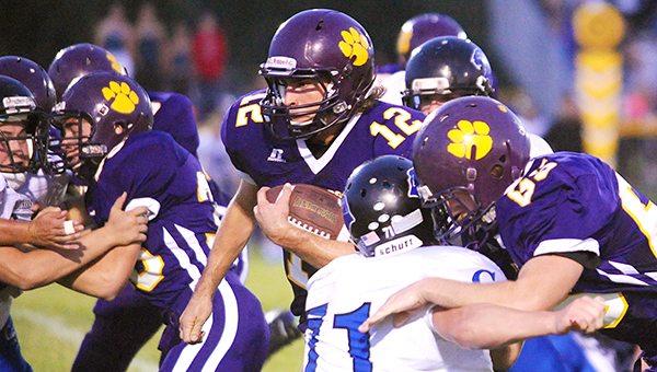 Josh Peters runs through the interior of the Central Springs defense Friday at home. Peters led the Bulldogs with 177 rushing yards on 22 carries. He scored three rushing touchdowns, all in the second quarter. — Micah Bader/Albert Lea Tribune
