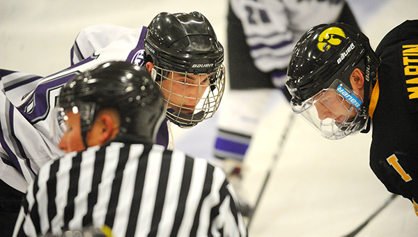 Jacob Bales of the Waldorf College men's hockey team waits for a face-off against Iowa's Alex Martin. — Micah Bader/Albert Lea Tribune