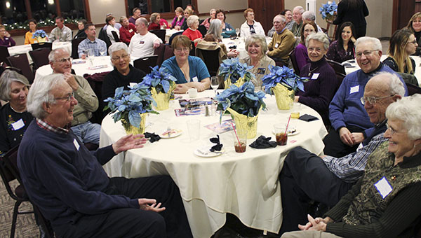 This table kept winning table prizes — blue poinsettias — at Business After Hours hosted by the Albert Lea Tribune in December 2012 at Wedgewood Cove Golf Club. – Tim Engstrom/Albert Lea Tribune