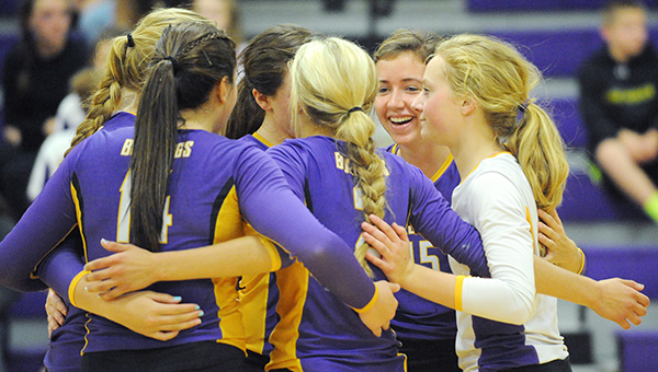 The Lake Mills volleyball team celebrates after scoring a point Tuesday against Newman Catholic during the first match of a triangular. Lake Mills swept Newman Catholic and North Iowa. — Micah Bader/Albert Lea Tribune