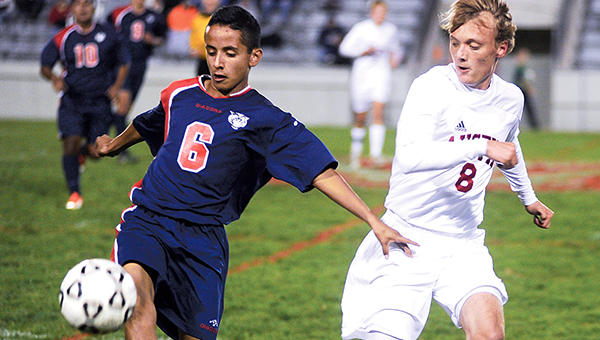 Albert Lea's Jesus Garcia-Gonzalez attempts to get the ball past Austin's Nate Brinkman during the first half Tuesday night at Art Hass Stadium. Austin won 3-1. According to Albert Lea coach Joe Squires, the Tigers scored within the first minute of the game and led 1-0 at halftime, but Austin scored three unanswered goals in the second half. — Eric Johnson/Albert Lea Tribune