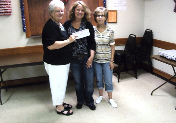 The Eagles Club donated to ARC. Accepting the check is Amy Vogt from Kathy Halvorson and Judy Myers, taco committee members. — Provided