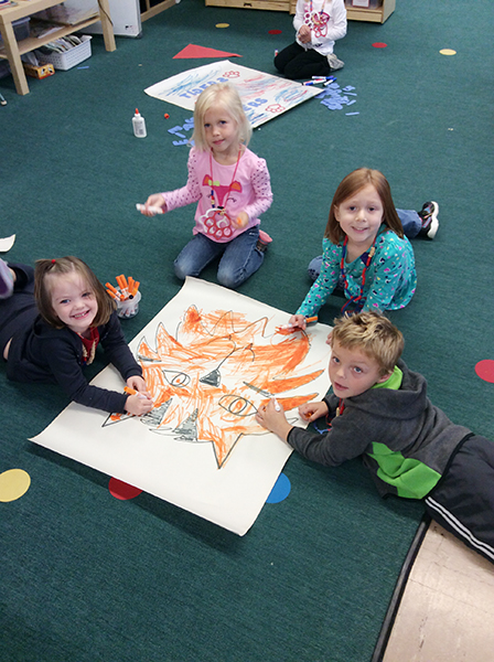Students from United Preschool color a tiger poster to celebrate Homecoming. — Provided