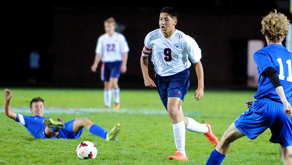 Porfirio Garcia of Albert Lea dribbles the ball down the center of the field before scoring the first goal of the game Tuesday durning the first round of the Section 1A tournament against Winona Cotter at Jim Gustafson Field. — Micah Bader/Albert Lea Tribune