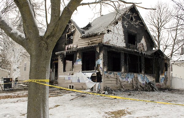 Most of the house at 403 Fifth Ave. W. in Ellendale sat blackened on the afternoon on the day after an arson fire in December 2011. – Sarah Stultz/Albert Lea Tribune