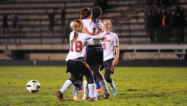 Albert Lea players celebrate a goal scored by Megan Kortan on a penalty kick late in the second half Thursday in the Section 2A quarterfinals at Jim Gustafson Field. From left are Haley Lamping, Holly Wichmann, Kortan and Claire Sherman. — Micah Bader/Albert Lea Tribune