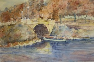 Although many of Steve Larson's paintings in his Albert Lea series have a blue theme to them, this painting of Hatch Bridge features rusty orange leaves. – Provided