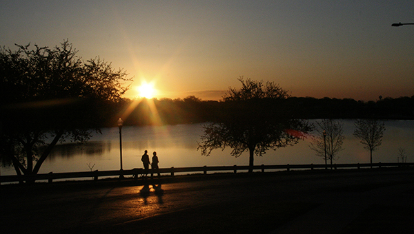 Two people and their dog jog down Fountain Street along Fountain Lake one morning in May 2009. – Tim  Engstrom/Albert Lea Tribune