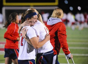 Albert Lea seniors Holly Wichmann, left, and Sarah Niebuhr celebrate a win over Mankato Loyola on Oct. 16 in the Section 2A finals at New Prague. – Micah Bader/Albert Lea Tribune