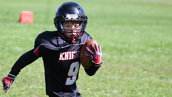 Taybor Conley of the fourth-grade Alden-Conger football team carries the ball Oct. 4 against Janesville-Waldorf-Pemberton. The fourth-, fifth- and sixth-grade football teams from Alden-Conger swept Janesville-Waldorf-Pemberton. The fourth-grade Knights won 8-0, the fifth-graders won 32-0 and the sixth-graders won 26-0. — Ann Glazier/For the Albert Lea Tribune