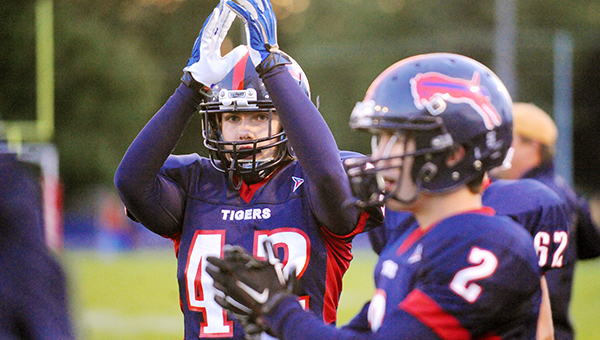 Dawson Luttrell, left, and Trent Johnston of Albert Lea celebrate after a fumble recovery in the first quarter on Sept. 12 against Northfield at Jim Gustafson Field.  The Tigers start the postseason at 7 p.m. Tuesday at Byron. — Micah Bader/Albert Lea Tribune