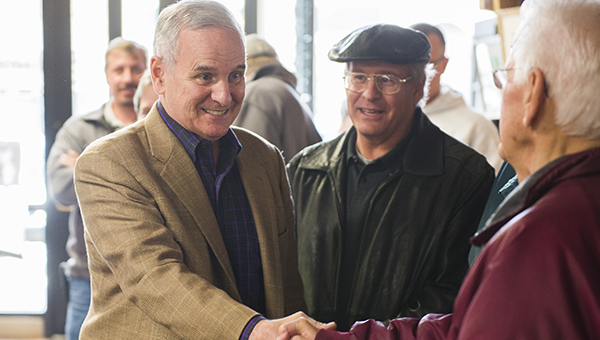 Gov. Mark Dayton greets those in attendance before speaking in support of House District 27A Rep. Shannon Savick Wednesday at Prairie Wind Coffee. — Colleen Harrison/Albert Lea Tribune