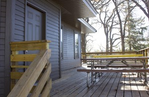 Parts of the deck were renovated on the Edgewater Cottage thanks to an effort from several local volunteers. – Sarah Stultz/Albert Lea Tribune