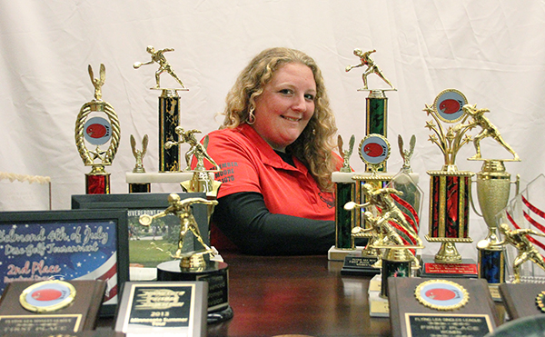 Albert Lea disc golfer December Moore is surrounded by her trophies.
