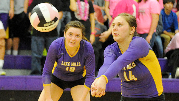 Cede Byrnes of Lake Mills digs the ball Tuesday against West Fork in the Class 2A Region 5 quarterfinals at home. — Micah Bader/Albert Lea Tribune