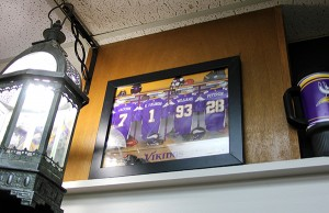 A personalized photo was given to Käri Fjeldberg as a gift with her jersey among three actual Vikings players. From left are Tarvaris Jackson, Fjeldberg, Kevin Williams and Adrian Peterson.