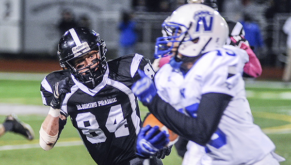 Blooming Prairie's Cole Byers-Sunde tracks Minneapolis North's Keyon Thomas during the third quarter in the Class A state quarterfinals in Richfield Friday night. — Eric Johnson/Albert Lea Tribune