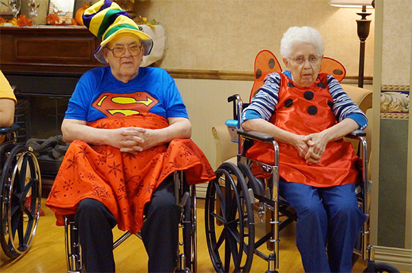 Residents at St. John's Lutheran Community watch a children's parade for Halloween on Friday. — Provided
