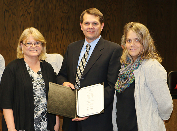Albert Lea Mayor Vern Rasmussen presents the Certificate of Achievement to the finance department on Oct. 27. Pictured are Tanya Harms, accountant; Rasmussen; and Kristi Brutlag, contract finance officer. – Provided