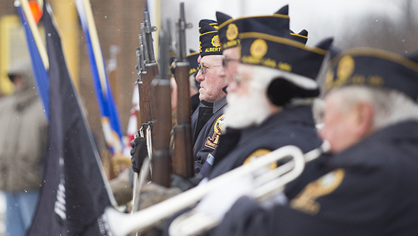 Members of local veterans organizations stand outside the Freeborn County Courthouse near a memorial during a Veterans Day program Tuesday. – Colleen Harrison/Albert Lea Tribune