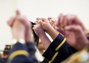 """Those in attendance join hands while singing """"God Bless America"""" toward the end of a Veterans Day program Tuesday at Freeborn County Courthouse. – Colleen Harrison/Albert Lea Tribune"""