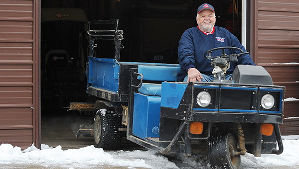 Retired Albert Lea Area Schools grounds manager, Bob Hamberg, sits on a Cushman cart from the '80s Tuesday outside a utility shed at Jim Gustafson Field. – Micah Bader/Albert Lea Tribune