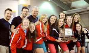 The Albert Lea girls' swimming team celebrates a third-place finish on Nov. 14 in the Class A state meet at the University of Minnesota Aquatic Center. – Micah Bader/Albert Lea Tribune
