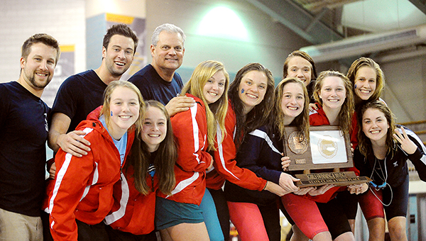 The Albert Lea girls' swimming team celebrates a third-place finish Friday in the Class A state meet at the University of Minnesota Aquatic Center. — Micah Bader/Albert Lea Tribune