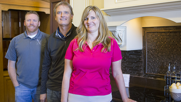 Freeborn Lumber Co. & Design operations manager Brandon Kroeger, owner John Miller and chief financial officer Tiffany Kriesel stand in the showroom at the business on Friday. – Sarah Stultz/Albert Lea Tribune