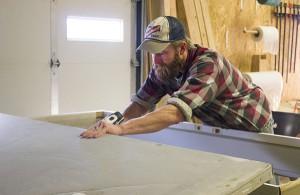 Micah Aronson, installer at Freeborn Lumber Co. & Design, works on a door Friday. – Sarah Stultz/Albert Lea Tribune