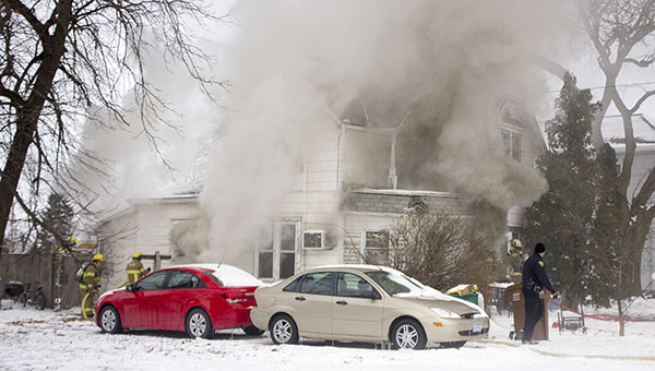 Smoke billows out of the windows of a home at 248 N. Broadway in Alden Tuesday afternoon. — Sarah Stultz/Albert Lea Tribune