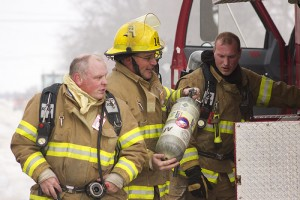 Firefighters prepare to fight a fire in a home at 248 N. Broadway in Alden on Tuesday. — Sarah Stultz/Albert Lea Tribune