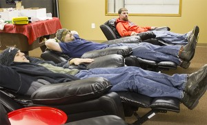 Northwood firefighters Bradley Christianson, Jake Hanson and Nathan Buehrer relax Thursday evening in three of the new recliners given as part of the $10,000 makeover awarded by California Casualty. — Sarah Stultz/Albert Lea Tribune