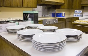 Part of the $10,000 makeover awarded to the Northwood Volunteer Fire & Rescue Company included new plates and silverware for the kitchen, which serves about three meals a month. — Sarah Stultz/Albert Lea Tribune