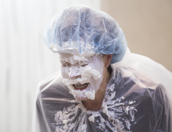 Tricia Dahl laughs after getting multiple pies in the face Thursday at Mayo Clinic Health System in Albert Lea. The event was an incentive for Mayo employees who participated in a United Way campaign drive. — Colleen Harrison/Albert Lea Tribune