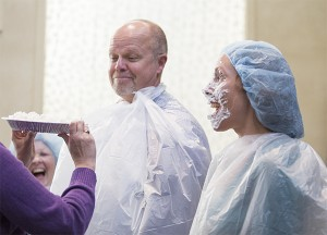 United Way of Freeborn County Executive Director Ann Austin, right, reacts after getting a pie in the face Thursday at Mayo Clinic Health System in Albert Lea. Austin was one of five people who volunteered to get creamed as part of an incentive for a United Way campaign drive. — Colleen Harrison/Albert Lea Tribune