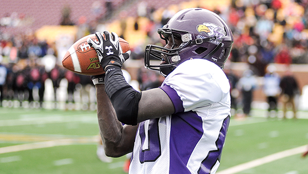 Grand Meadow's Cody Ojulu hauls in a pass that he turned and ran for 56 yards for a second-quarter touchdown in the Minnesota State Prep Bowl Nine Man championship Friday against Edgerton-Ellsworth at TCF Bank Stadium in Minneapolis. — Eric Johnson/Albert Lea Tribune