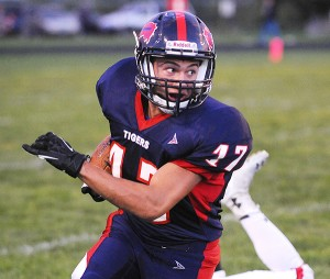 Sam Thompson of Albert Lea breaks contain and runs down the right sideline on Sept. 5 against Austin at Jim Gustafson Field. Thompson suffered a knee injury later in the season but plans to be back for wrestling season. — Micah Bader/Albert Lea Tribune