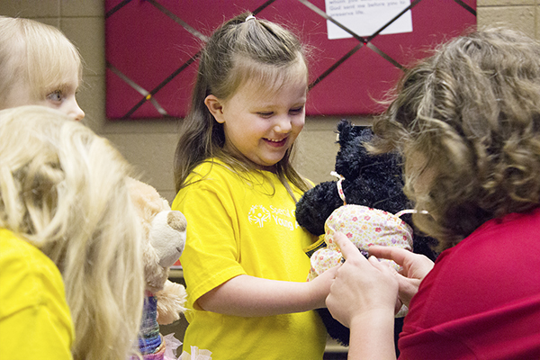 A United Preschool student excitedly shows off her bear's tail to Audra Beussman on Thursday. United Preschool got a donation of 200 Build-A-Bears from Young Athletes, who were donated the bears by Starkey Hearing Technologies. – Hannah Dillon/Albert Lea Tribune