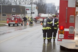 Firefighters from Geneva, Clarks Grove and Hartland suit up before responding to a leak in an anhydrous ammonia tank on a semi at Clarks Grove Fertilizer near the grain elevator. – Colleen Harrison/Albert Lea Tribune