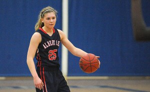 Sydney Rehnelt of Albert Lea handles the ball on Jan. 24 against Austin at Albert Lea. Rehnelt passed the 1,000-career point barrier on March 5 against Waseca in the Section 1AAA quarterfinals. – Micah Bader/Albert Lea Tribune
