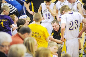 Lake Mills head coach Kyle Menke instructs his team during a timeout on Feb. 25 in the Class 1A District 3 semifinals against Rockford in Lake Mills. – Micah Bader/Albert Lea Tribune